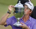Third Place | Photo StoryJerry Wolford, News-RecordWebb Simpson kisses the Sam Snead Cup after winning the Wyndham Championship