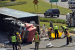 Second Place | Spot NewsErin Brethauer, The Asheville Citizen-TimesA tractor-trailer wreck on I-240 in Asheville created major traffic backups in the westbound lane of I-240 and on I-26 East near downtown.  The 9:45 a.m. wreck near the Smokey Park Bridge injured the truck driver.  9/14/11
