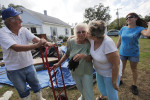 First Place | Photo StoryShawn Rocco, The News and ObserverJack Sadler, left, and Maggie Sawyer watch as Doris Goodwin-Sawyer, center right, kisses Lucille Sadler, as the Sadlers take a break from moving flood-damaged furniture out of their house and to the curb in Hobucken.