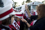 Second Place | Photo StoryJerry Wolford, News-RecordDeborah Roskelly places the plumes on the Page marching band's hats.