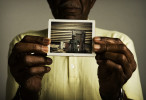 First Place | Photo StoryJames Robinson, Fayetteville ObserverPhilip Purnell, Vietnam Vet, with photo taken of him in 1970 in Tan-An