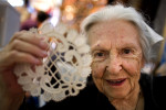 Third Place | Photo StoryJerry Wolford, News-RecordAmina Abdelkader's, age 89, holds her hand made needle lace for sale in the crafts area.