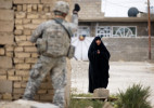 Honorable Mention | General NewsJames Robinson, Fayetteville ObserverA member of  3rd Platoon C Company 2nd Battalion 325th Infantry Regiment signals to an Iraqi civilian while guarding the perimeter during a mission to Hadi Hasan to talk with local leader Abu Adil Thursday morning.