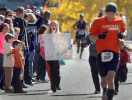 Honorable Mention | SportsTodd Sumlin, The Charlotte Observer Taylor Koziarz chases her father Kris to the finish line at  the Thunder Road Marathon in uptown Charlotte Saturday, November 12, 2011.