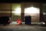 First Place | Photo StoryShawn Rocco, News & ObserverAn inflatable Santa is knocked over by customers heading to the back door of Best Buy in order to load up their larger purchases.