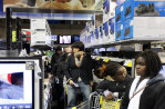 First Place | Photo StoryShawn Rocco, News & ObserverIsaac Choi, 16, waits in line to purchase two flat-screen televisions and two Blu-Ray players.