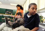 Second Place | Photo StoryGray Whitley, The Wilson Times11.3.2011 - Malik Morris, 15, a deaf/blind student at the Eastern North Carolina School for the Deaf, looks at the light of a decorated lamp in the corner of classroom. Malik has multiple handicaps and has limited vision, he can see better from his right eye better than his left eye.