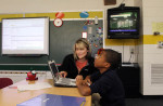 Second Place | Photo StoryGray Whitley, The Wilson Times11.3.2011 - Krystal Cooper, deaf/blind intervenor, helps Malik Morris, 15, with an interactive lesson plan on the computer during class at the Eastern North Carolina School for the Deaf. Malik, who has CHARGE syndrome, will briefly have his attention elsewhere. Malik has been a deaf/blind residential student at the school for seven years.