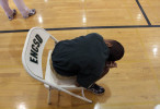 Second Place | Photo StoryGray Whitley, The Wilson Times11.3.2011 - Malik Morris, 15, a deaf/blind student, bends over while sitting in a chair during P.E. class at the Eastern North Carolina School for the Deaf. Krystal Cooper, Malik's deaf/blind intervenor, remains close by. The act of bending over is a relief method to Malik, who has CHARGE syndrome. He learned the technique during physical and occupational therapy at the school.