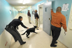 Second Place | General News Brad Coville, The Wilson Times12/30/2011 - A sheriff's K-9 unit prepares to enter a jail cell during a sweep for narcotics December 30, 2011.