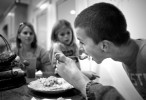 First Place | Photo StoryJerry Wolford, News-RecordRyan Leonard eats a second helping of macaroni as his mother, Kyna, and sister Mia, 9, talk to him about his day.