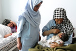 First Place | News Photo Story Ted RichardsonInfant mortality rates are higher in Afghanistan than anywhere else in the world, often due to men not allowing their wives to go to the hospital.  Hazara mothers seek assistance with their newborns at a clinic in Bamiyan.