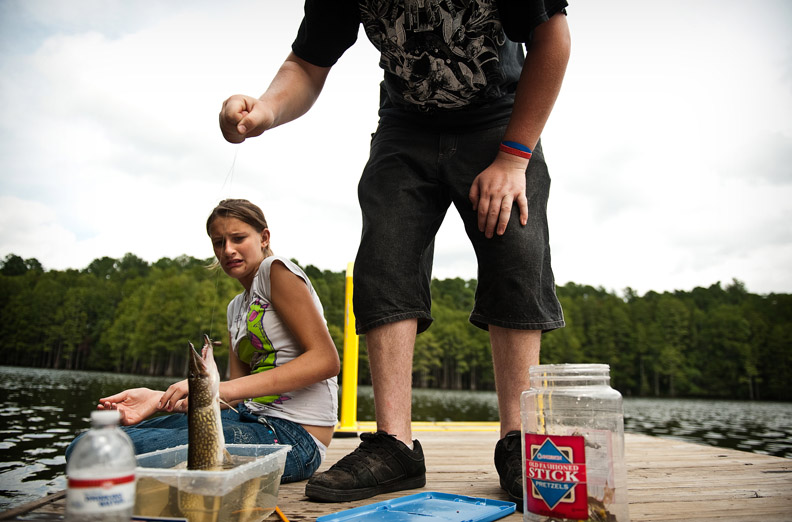 POY, Runner UpAndrew Craft, Fayetteville Observer Bethany Roderick, left, reacts as her brother, Kyle Roderick, places a pickerel fish into a plastic container after catching it Monday, Sept. 5, 2011, on Glenville Lake in Fayetteville, N.C.
