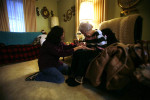 Student Photographer of the YearSpencer Bakalar, UNC-Chapel HillMarlina Coomer visits and reads with many elderly residents of Pulaski County. She prays with 93-year-old {quote}Miss B{quote} Dykes.