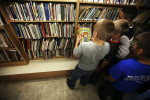 Student Photographer of the YearSpencer Bakalar, UNC-Chapel HillBoys gather around the book {quote}Yucky Stuff{quote} while visiting the bookmobile. {quote}Woah, YES!{quote} one says.