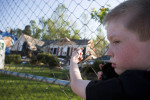 Student Photographer of the YearSpencer Bakalar, UNC-Chapel HillWill Tucker, 7, of central Raleigh looks at the site of two houses on Serendipity Drive, destroyed after the tornadoes in April.