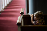 Student Photographer of the YearSpencer Bakalar, UNC-Chapel HillSecluded in the back of the chapel at Southeastern Baptist Theological Seminary located Wake Forest, N.C., a young girl watches her mother  worship.