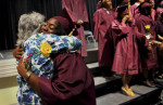 Student POY: Runner upStephen Mitchell, UNC-Chapel HillSusan Clements, a math facilitator, hugs graduate Shaquana Singletary at Durham Performance Learning Center's graduation ceremony.