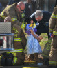 First Place | Spot News Todd Sumlin, The Charlotte Observer A little girl clings to her baby doll as Charlotte firefighters, Matthew Harrington, top left, and Michael Brewer, lower left, and Charlotte/Douglas Airport Police officer Tim Hare tend to her following a multi-vehicle crash on Wilkinson Blvd. at Harlee Ave. Friday, January 27, 2012. Charlotte firefighters and airport police were among the first to respond to the crash. Two adults and two children were injured in the wreck that temporarily closed the eastbound lanes of Wilkinson Blvd.