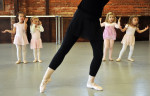 First Place | FeatureErin Brethauer, The Asheville Citizen-TimesDirector Angie Lynn leads a group of girls in the ages 3-5 class at the Ballet Conservatory of Asheville Wednesday afternoon.  The conservatory, which has been open two and half years, is a pre-professional school which also features children's classes.  After years of being a professional ballet dancer, Lynn has been teaching the past eight years.  {quote}It helps being a mom,{quote} says the mother of three, {quote}It's really their introduction into the whole world of ballet.{quote}