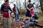 Second Place | Photo StoryJerry Wolford, News-RecordThe boys settle on a frame choice. It is almost too pink but it will work. They have to use small tires salvaged from a small child's sized bike on the BMX frame.