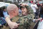 Honorable Mention | General NewsChuck Beckley, Jacksonville Daily NewsSam Butler gives friend, Sgt. Tyler Toliver one happy hug as he departed the buss Sunday afternoon at Camp Lejeune.  630 Marines and sailors with Batalion Landing Team, 2nd Battalion, 2nd Marine Regiment, approximately 130 Marines and sailors with Combat Logistics Battalion 22 and 200 Marines and sailors with the command element returned to Camp Lejeune.