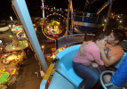 First Place | General NewsScott Muthersbaugh/Burlington Times3/16/12 - Monce Rodriguez, 16, and Ramon Paredes, 17, both from Mebane, N.C., embrace on the ferris wheel at the Powers Great American Midway Carnival in Burlington, N.C. on Friday, March 16th, 2012. JUDGES COMMENTS: Nice intimate moment. Excellent ability on part of the photographer to get a unique perspective. Also, showing good use of light in the scene, flash and ambient.