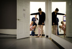 Third Place | FeatureJames Robinson, The Fayetteville ObserverCharlotte Mills and Arianne Monroe peek around the door at the start of ballet class at Carolina Performing Arts Center.JUDGES COMMENTS: Off center composition makes it work well.