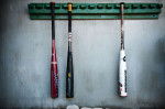 First Place | Photo StoryAndrew Craft, The Fayetteville ObserverBats hang in the dugout at the USA Baseball H.S. Invitational in Cary, N.C.