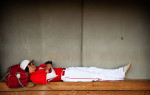 First Place | Photo StoryAndrew Craft, The Fayetteville ObserverMater Dei's Tyler Kiehnle takes a nap in a dugout during a four-hour rain delay of the championship game at the USA Baseball H.S. Invitational in Cary, N.C.