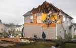 Third Place | Photo StoryTodd Sumlin, The Charlotte ObserverHerb Underwood examines the damage at his girlfriend's home in northeast Charlotte following an early morning tornado Saturday, March 3, 2012.