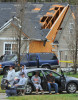 Third Place | Photo StoryTodd Sumlin, The Charlotte ObserverResidents wait and watch as emergency workers and utility crews examine the damage on Satterfield Ct. in Charlotte, N.C. following an early morning tornado Saturday, March 3, 2012.