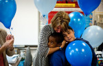 Honorable Mention | General NewsAndrew Craft, The Fayetteville ObserverTeacher Amy Sparks hugs her students, Tyrese Benjamin and Hailei Longoria, Tuesday as they get ready for their balloon release at VanStory Elementary School. Amy Sparks' third grade class released the balloons in memory of her autistic son, Jarred Sparks, who died last year. Tuesday would have been his 20th birthday.JUDGES COMMENTS: Perfect emotion, composition too loose