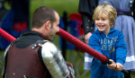 Third Place | Photo StoryJerry Wolford, News & RecordDante Kroll, 6, hits a member of the European Medieval Arts of Arms group with a foam sword as they spar.