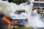 Second Place | Spot NewsJerry Wolford, News & RecordLt. Grady Starnes of the Guil-Rand Fire Department extinguishes a Ford truck in flames with the help of Engine 201 along side Archdale Rd. in Trinity on Wednesday, June 6, 2012 in Archdale, NC.