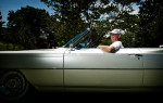 Third Place | PortraitAndrew Craft, The Fayetteville ObserverJim Smith in his 1964 Cadillac Coupe de Ville convertible.