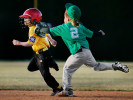 First Place | Photo StoryMark Dolejs, Daily DispatchAs she chases down a Bishop Photo base runner for the last out of their game, Allie Rose's ball cap comes off revealing her ponytail.