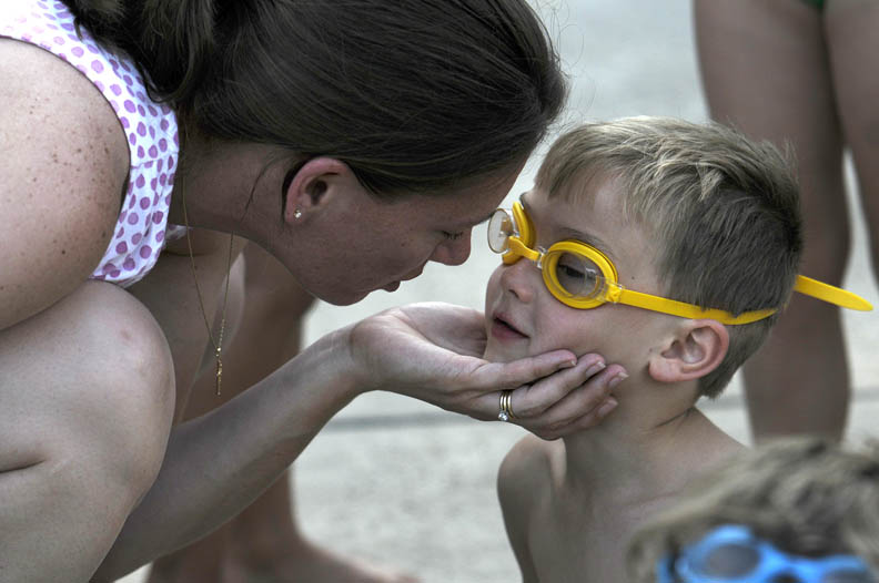 Second Place | Photo StoryJohn D. Simmons, The Charlotte ObserverMarlena Travers gives her five-year-old son Jake Travers some words of encouragement before the start of an evening swim meet at the Davis Lake pool.