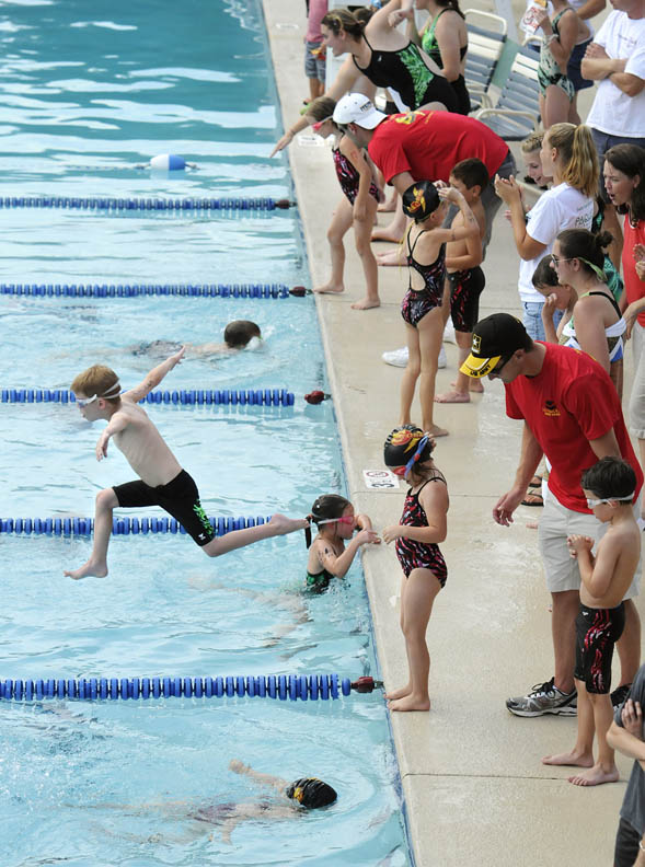 Second Place | Photo StoryJohn D. Simmons, The Charlotte ObserverDiving to start a swimmer's turn in a relay is optional for younger swimmers as just getting into the water is of higher concern.