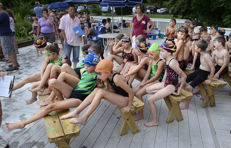 Second Place | Photo StoryJohn D. Simmons, The Charlotte ObserverSwimmers move from bench to bench in the race staging area during a meet between Davis Lake and Skybrook subdivisions. The closer the swimmers get to the front bench the sooner their race is going to happen.