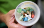 Third Place | Photo StoryJerry Wolford, News & RecordThe {quote}gum cup{quote} with a colorful assortment of used gum is passed for students to get rid of their chewing gum.