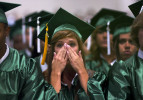 Third Place | Photo StoryJerry Wolford, News & RecordCatherine Baratta wipes her tears during the ceremony.