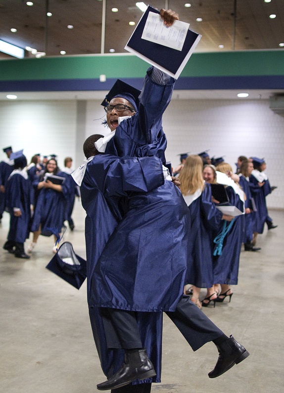 Third Place | Photo StoryJerry Wolford, News & RecordLandis Shoffner celebrates after graduation.