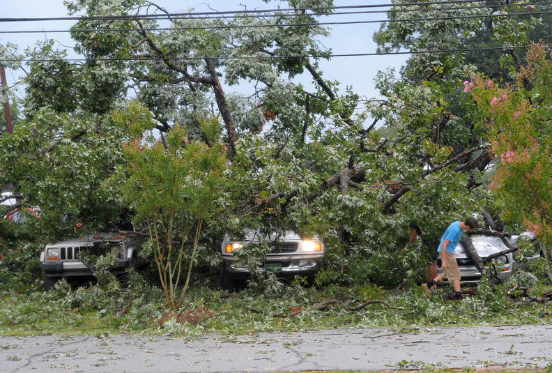 Second Place | Spot NewsScott Muthersbaugh, Burlington Times7/27/12 - Roman Stanley, 16, surveys the damage done to his Ford Mustang after a tree fell on three vehicles at the corner of West Ruffin Street and North Fourth Street in Mebane, N.C. Friday, July 27, 2012. Strong storms swept through the region downing many trees and causing estensive damage to vehicles and homes. JUDGES COMMENTS: We liked the use of how the photographer took a step back to show the scene. It could have lost context up close.