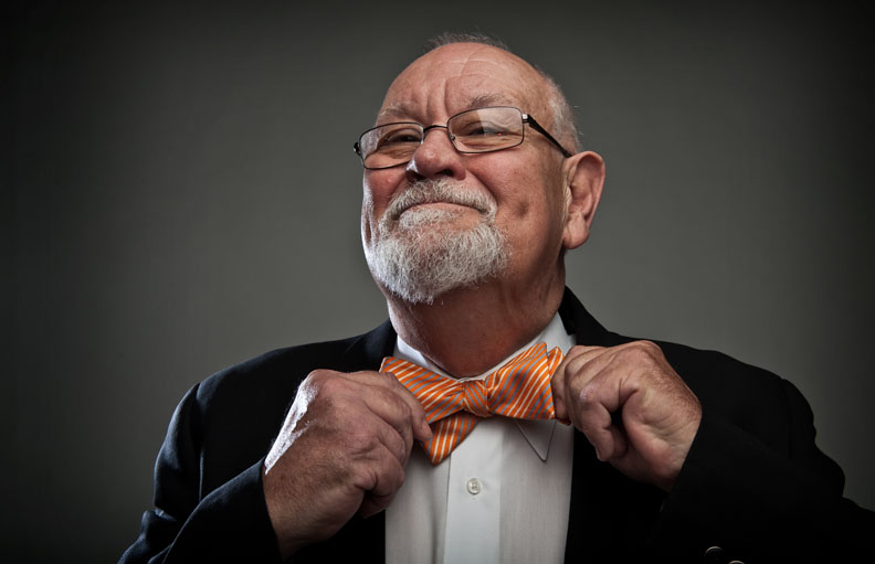 First Place | PortraitAndrew Craft, The Fayetteville ObserverLawyer Jack Carter and his bow tie.JUDGES COMMENTS: Classic. Personality shines through. It s playful, simple. Watch that accent light on the hand, it s a touch distracting and vignetting post.