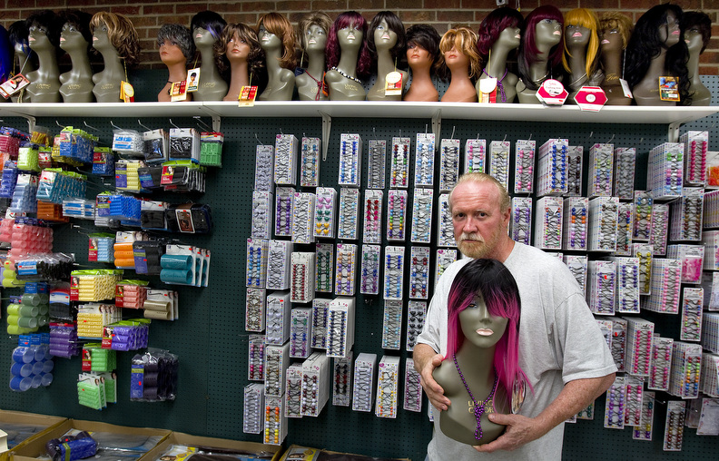 Honorable Mention | PortraitJerry Wolford, News & RecordCharles Lee has thousands of hair supply items and over sixty wigs on display at his store.JUDGES COMMENTS: A dynamic juxtaposition between the row of wigs and the one being held. It s quirky and fun. Colorful.