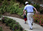 First Place | Photo StoryJerry Wolford, News & RecordGolfer Webb Simpson chases his son, James Simpson, age 18 months, up the sidewalk after finishing his round.