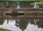 First Place | Photo StoryJerry Wolford, News & RecordSergio Garcia, of Spain (center), walks over the lake to the 16th green.