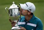 First Place | Photo StoryJerry Wolford, News & RecordSergio Garcia kiss the Sam Snead Cup after winning the rain delayed Wyndham Championship at Sedgefield Country Club in Greensboro, NC.