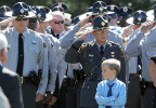 Third Place | Photo StoryBrad Coville, The Wilson TimesA young boy stands in front of hundreds of North Carolina Highway Patrol Troopers as the flag draped casket carrying the body of slain Trooper Bobby Gene DeMuth Wednesday, September 12, 2012 in Rocky Mount, N.C.
